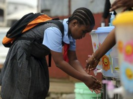686631-a-pupil-washes-her-hands-with-an-improvised-tap-in-front-of-the-school-premises-at-the-resumption-of